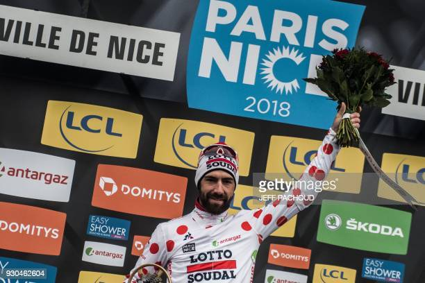 Belgium's Thomas De Gendt celebrates his best climber's polka dot jersey on the podium during the 110 km eighth and last stage of the 76th edition of...