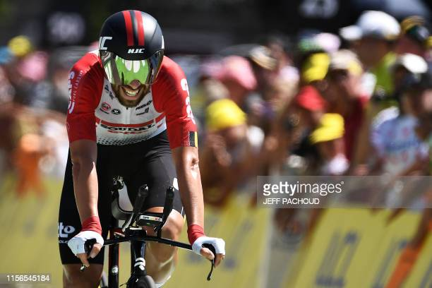 Belgium's Thomas De Gendt crosses the finish line of the thirteenth stage of the 106th edition of the Tour de France cycling race, a 27,2-kilometer...