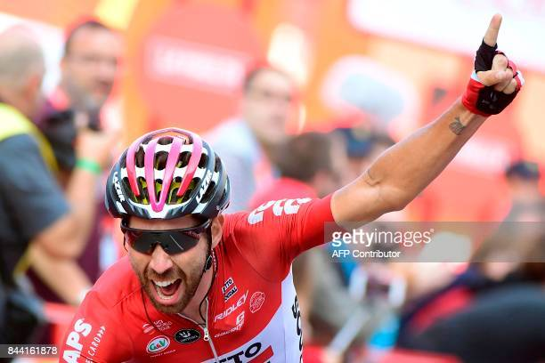 Belgium's Thomas De Gendt of team LottoSoudal celebrates as he crosses the finish line to win the 19th stage of the 72nd edition of 'La Vuelta' Tour...