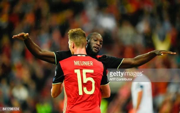 Belgium's Thomas Meunier celebrates with Belgium's forward Romelu Lukaku after scoring a goal during the WC 2018 football qualification football...