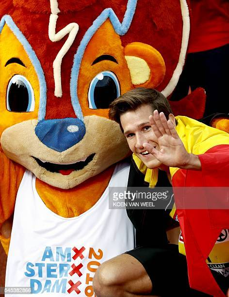 Belgium's Thomas van der Plaetsen poses with the mascot after competing in the men's decathlon 1500 m race during the European Athletics...