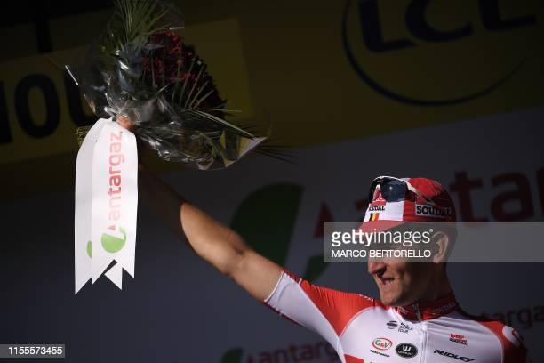 Belgium's Tiesj Benoot celebrates his prize for day's most combative rider on the podium of the ninth stage of the 106th edition of the Tour de...