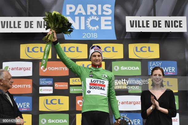 Belgium's Tim Wellens celebrates his green jersey of best sprinter on the podium at the end of the 110 km eighth and last stage of the 76th edition...