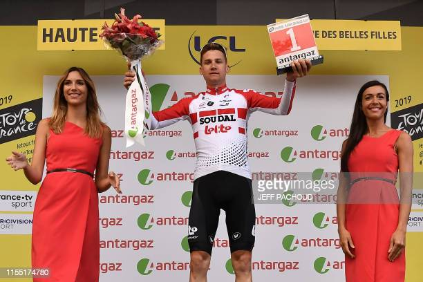Belgium's Tim Wellens celebrates his prize for day's most combative rider on the podium of the sixth stage of the 106th edition of the Tour de France...