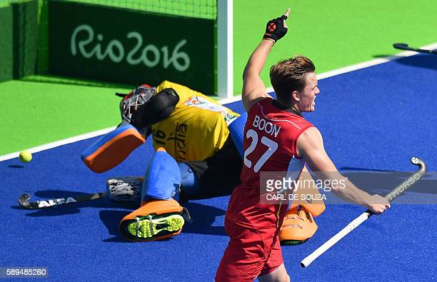 Belgium's Tom Boon celebrates his team's goal during the men's quarterfinal field hockey Belgium vs India match of the Rio 2016 Olympics Games at the...