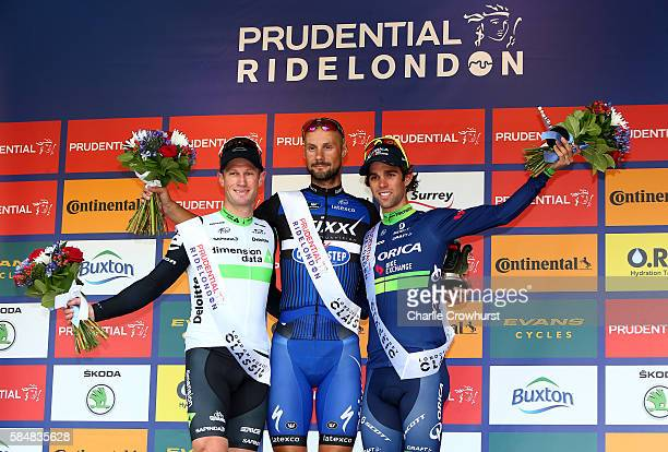 Belgium's Tom Boonen of Etixx Quick Step celebrates after winning the sprint with second place Mark Renshaw of Team Dimension Data and Michael...