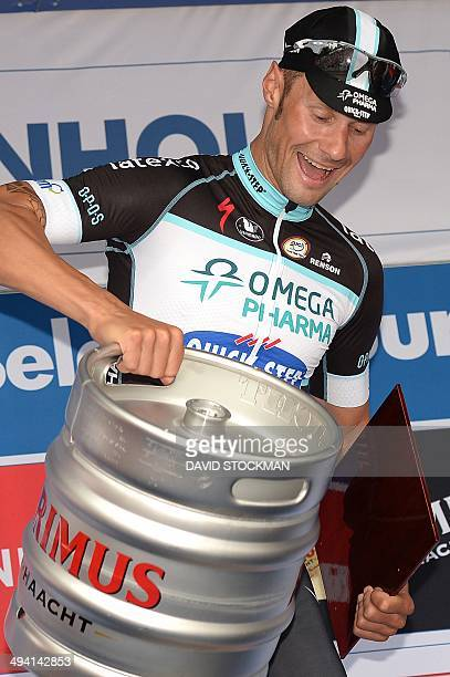 Belgium's Tom Boonen of team Omega PharmaQuick Step holding a beer barrel celebrates on the podium after winning the 1st stage of the Baloise Belgium...