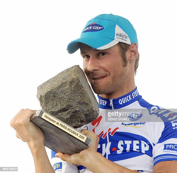 Belgium's Tom Boonen poses with his trophy on the podium after he crossed the finish line of the 107th edition of the ParisRoubaix cycling race...