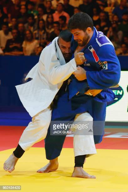 Belgium's Toma Nikiforov competes against France's Cyrille Maret during their men's Final under 100 kg weight category competition during the...