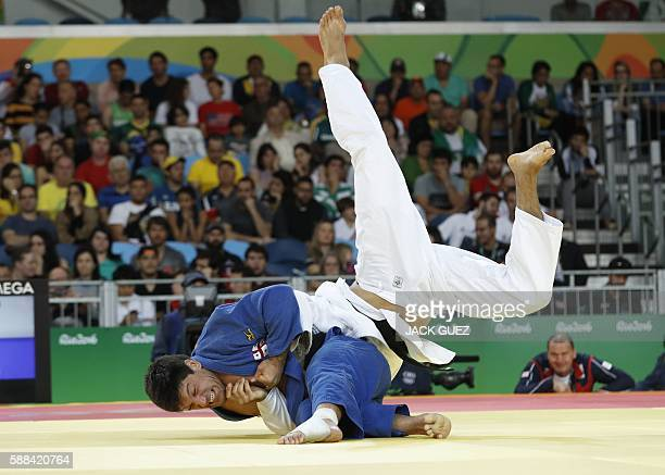 Belgium's Toma Nikiforov competes with Georgia's Beka Gviniashvili during their men's -100kg judo contest match of the Rio 2016 Olympic Games in Rio...