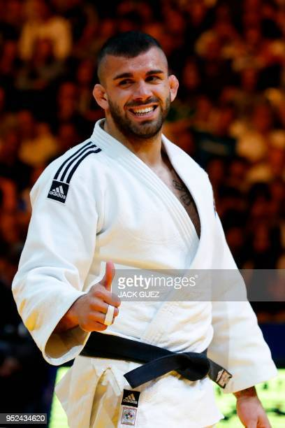 Belgium's Toma Nikiforov reacts after defeating France's Cyrille Maret during their men's Final under 100 kg weight category competition during the...