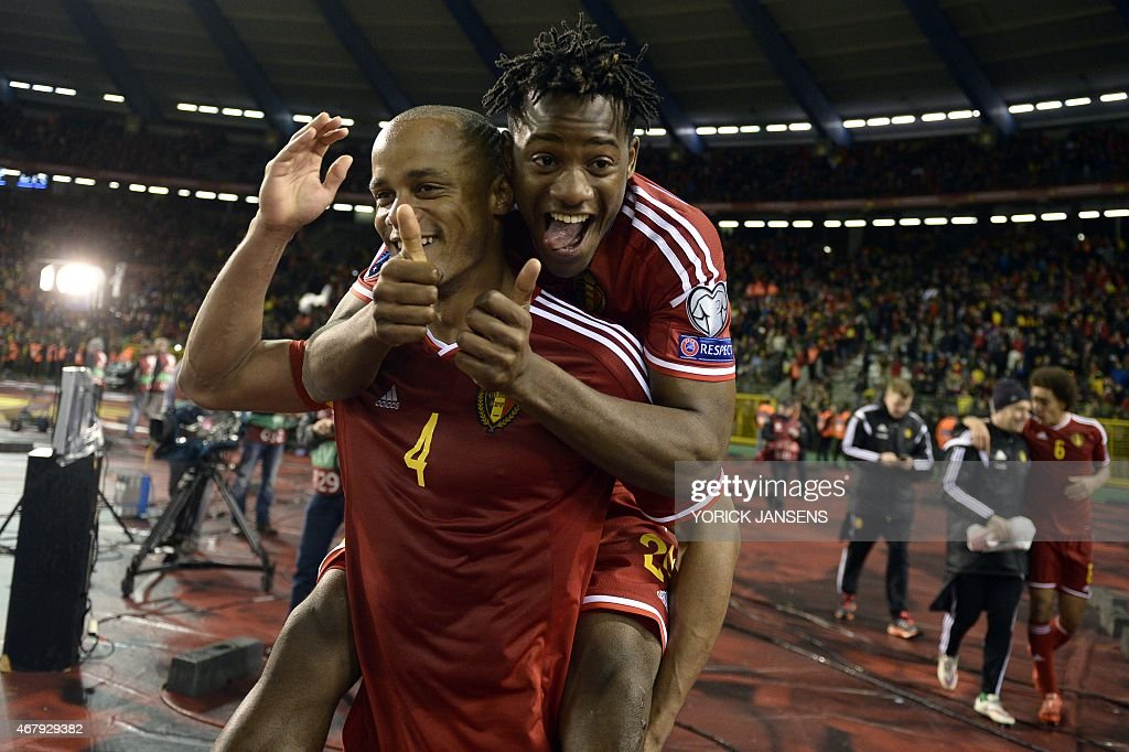Belgium's Vincent Kompany (L) and Belgium's Michy Batshuayi celebrate after winning the Euro 2016 qualifying round football match between Belgium and Cyprus at the King Baudouin stadium in Brussels on March 28, 2015.