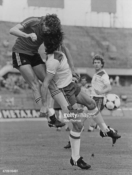 Belgium's Walter Meeuws gets above England's Dave Watson to head clear during their Group B match at the 1980 European Championships at the Stadio...