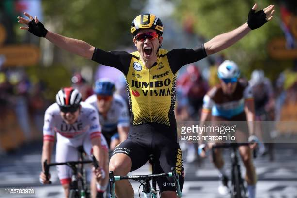 TOPSHOT Belgium's Wout van Aert celebrates as he wins on the finish line of the tenth stage of the 106th edition of the Tour de France cycling race...