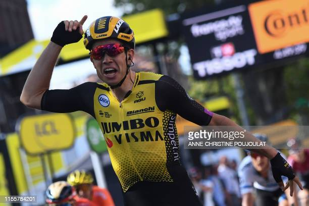 Belgium's Wout van Aert celebrates as he wins on the finish line of the tenth stage of the 106th edition of the Tour de France cycling race between...
