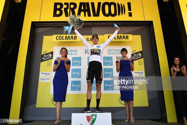 Belgium's Wout van Aert celebrates his best young's white jersey on the podium of the 106th edition of the Tour de France cycling race between...