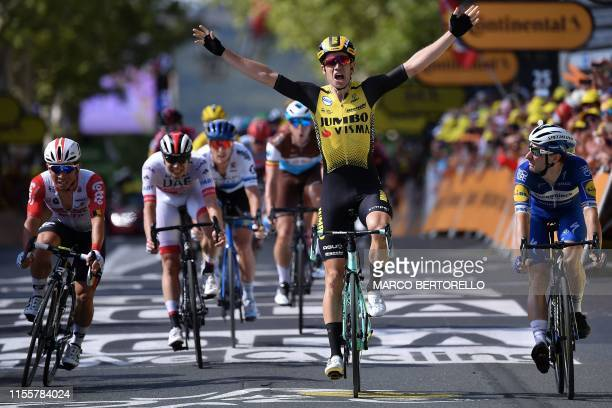 Belgium's Wout van Aert celebrates, past Australia's Caleb Ewan and Italy's Elia Viviani, as he wins on the finish line of the tenth stage of the...