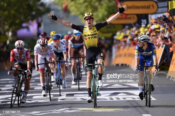 TOPSHOT Belgium's Wout van Aert celebrates past Australia's Caleb Ewan and Italy's Elia Viviani as he wins on the finish line of the tenth stage of...