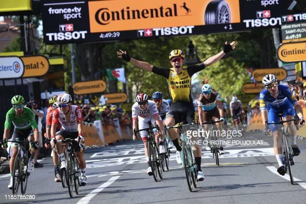 Belgium's Wout van Aert celebrates past Slovakia's Peter Sagan Australia's Caleb Ewan and Italy's Elia Viviani as he wins on the finish line of the...