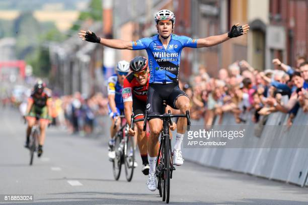 Belgium's Wout van Aert of Veranda's Willems Crelan celebrates as he crosses the finish line to win the 51st edition of the one day cycling race...