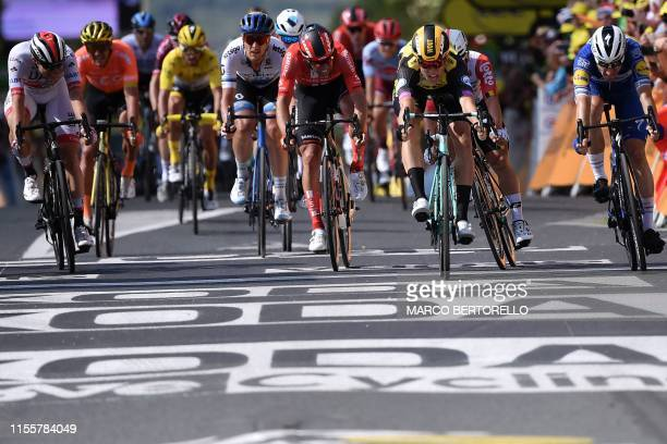 TOPSHOT Belgium's Wout van Aert sprints to win on the finish line of the tenth stage of the 106th edition of the Tour de France cycling race between...