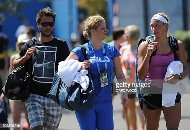 Belgium's Yanina Wickmayer speaks with former champion Kim Clijsters after a practice session ahead of the 2016 Australian Open tennis tournament in...