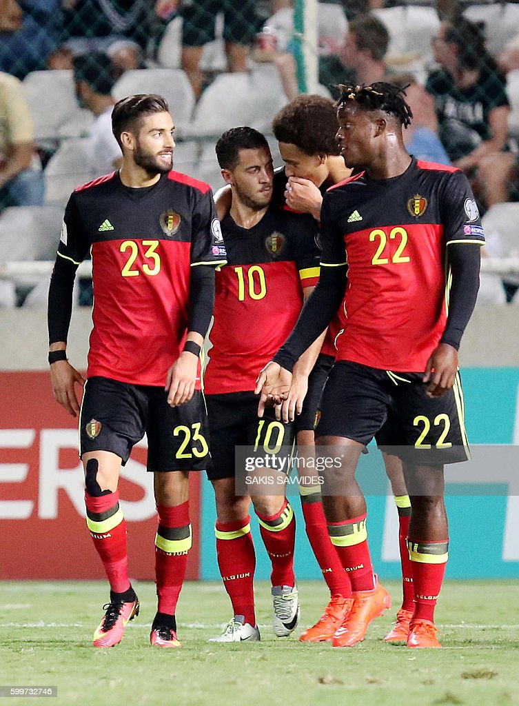Belgium's Yannick Carrasco (L) celebrates with teammates after he scored a goal during the World Cup 2018 Europe qualifying football match Cyprus versus Belgium on September 6, 2016 at the GSP Stadium in Nicosia. / AFP / Sakis Savvides