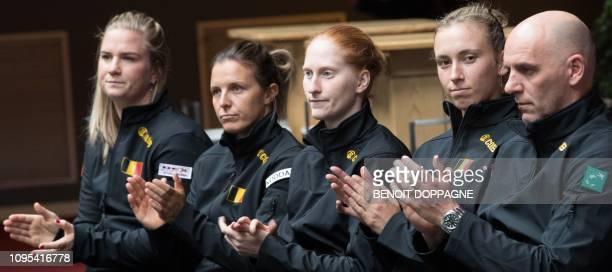 Belgium's Ysaline Bonaventure Kirsten Flipkens Alison Van Uytvanck Elise Mertens and captain Johan Van Herck are pictured during the draw of the...