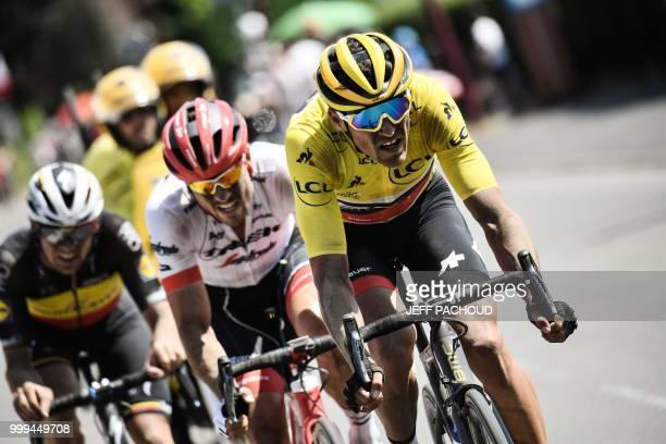 Belgium's Yves Lampaert, Germany's John Degenkolb and Belgium's Greg Van Avermaet, wearing the overall leader's yellow jersey, ride during the ninth...