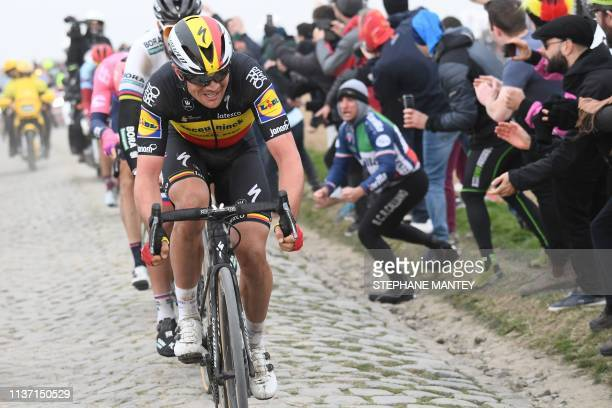 Belgium's Yves Lampaert rides on the Roubaix cobbled stones sector during the 117th edition of the Paris-Roubaix one-day classic cycling race,...
