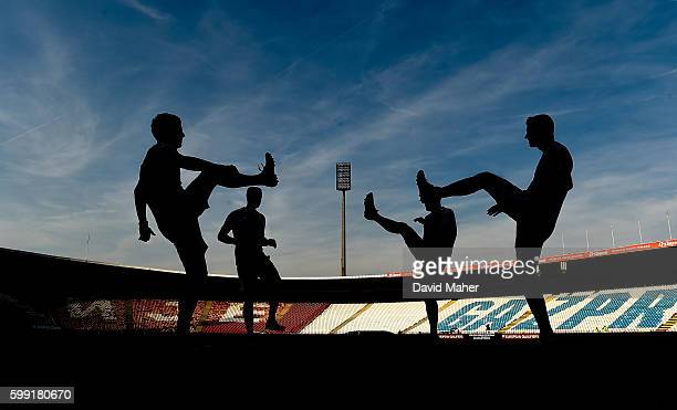 Belgrade Serbia 4 September 2016 A general view as the referee and his assistants warm up at the Stadion FK Crvena Zvezda in Belgrade Serbia