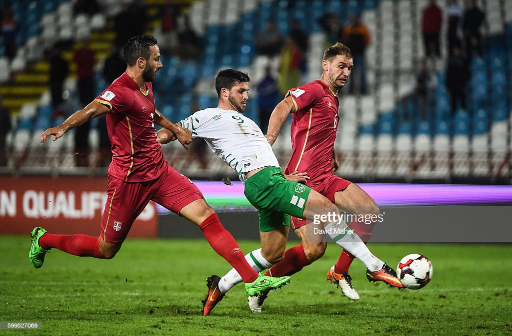 Belgrade , Serbia - 5 September 2016; Shane Long of Republic of Ireland in action against Jagos Vukovic, left, and Branislav Ivanovic, far right, of Serbia during the FIFA World Cup Qualifier match between Serbia and Republic of Ireland at the Red Star Stadium in Belgrade, Serbia.