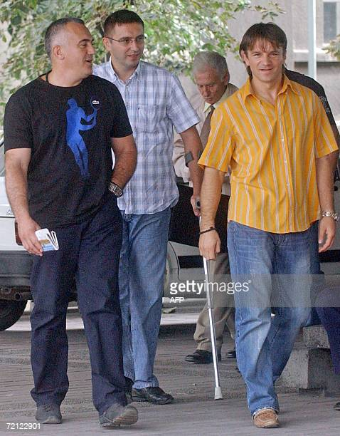 A file photo taken 04 October 2006 shows Dobrosav Gavric Milan Djurisic and Vujadin Krstic walking to the court in Belgrade A Belgrade court 09...