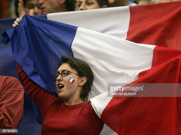 French supporter waves national flag 24 September 2005 during the semi final Greece/France game of the European basketball Championships at Belgrade...