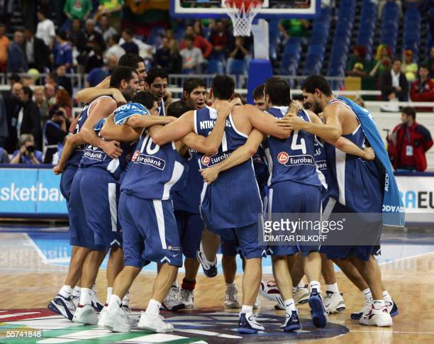 Greeks players jubilate 22 September 2005 at the end of the quarter final Russia/Greece of the European Basketball Championships at the Belgrade...