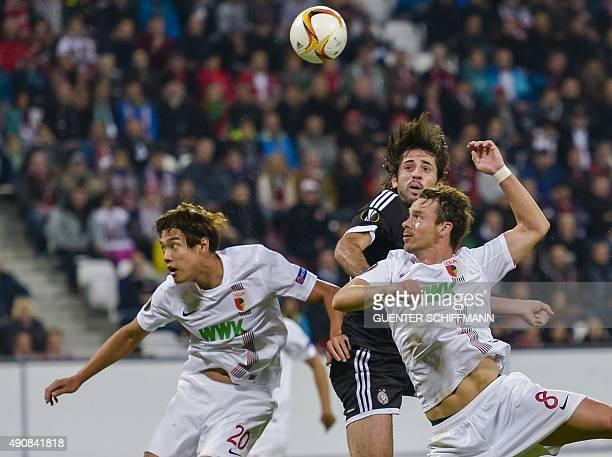 Belgrad's Serbian midfielder Stefan Babovic Augsburg's midfielder Markus Feulnerand and Augsburg's South Korean defender Jeong Ho Hong vie for the...