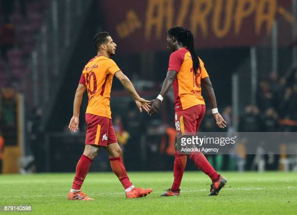 Belhanda and Gomis of Galatasaray congratulate each other after winning the Turkish Super Lig soccer match against Aytemiz Alanyaspor at Turk Telekom...