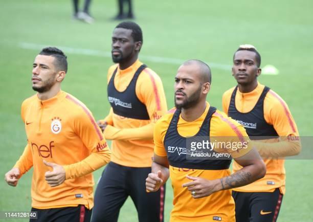 Belhanda Ndiaye Onyekuru and Marcao of Galatasaray attend a training session ahead of the Turkish Super Lig match between Galatasaray and Medipol...