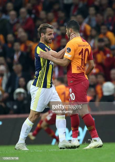 Belhanda of Galatasaray and Soldado of Fenerbahce argue with each other during Turkish Super Lig soccer match between Galatasaray and Fenerbahce at...