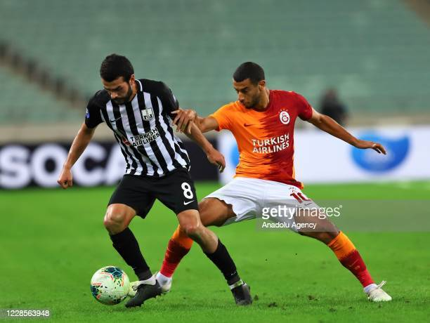 Belhanda of Galatasaray in action against Emin Mahmudov of Neftchi during the second qualifying round of the UEFA Europa League match between Neftchi...