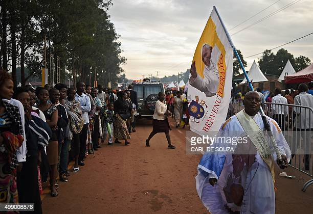 A believer arrives at Namugongo Martyrs' Shrine for an open air mass held by Pope Francis on November 28 2015 Pope Francis arrived in Uganda on...