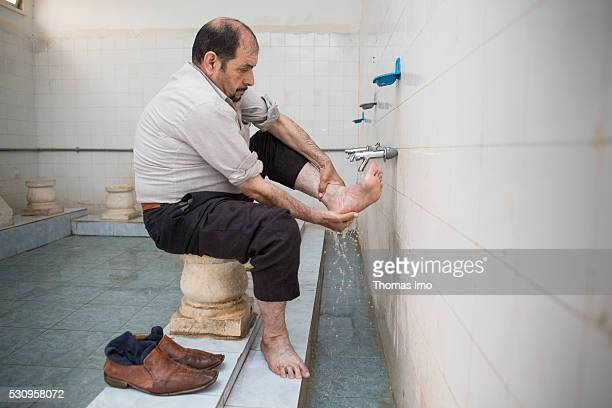 A believer in the ritual washing before prayer in the Usama ibn Zaid Mosque on April 05 2016 in Mafraq Jordan