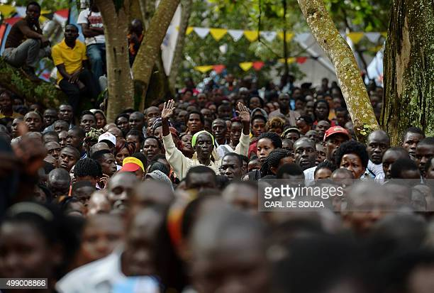 A believer reacts at Namugongo Martyrs' Shrine during an open air mass held by Pope Francis on November 28 2015 Pope Francis arrived in Uganda on...