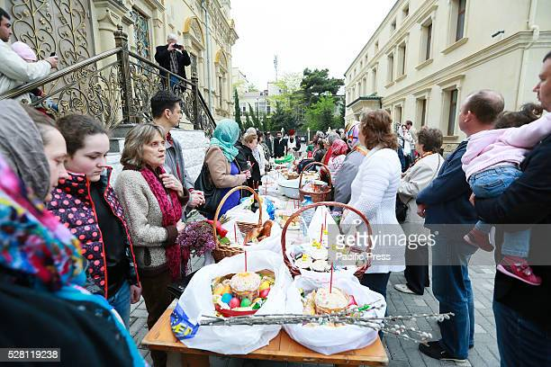 Believers and their families collected traditional cakes and painted eggs which have been blessed by a Russian Orthodox priest prepared for an Easter...