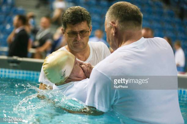 Believers are are baptised in the pool during quotBe Courageousquot Convention of Jehovahs Witnesses in Tauron Arena in Krakow Poland on 11 August...
