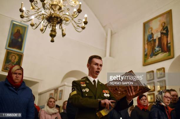 Believers attend an Orthodox Easter service in the village of Kreva some 100 km northwest of Minsk on April 28 2019