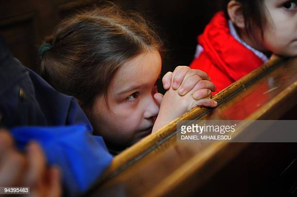 Believers attend s Sunday mess at the reformed Church 'Cetate' the starting point of the Romanian 1989 Revolution in Timisoara city on December 13...
