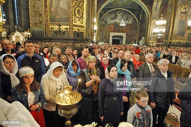 Believers attend the Orthodox Easter service at St Volodymyr cathedral in Kiev Ukraineon May 012016