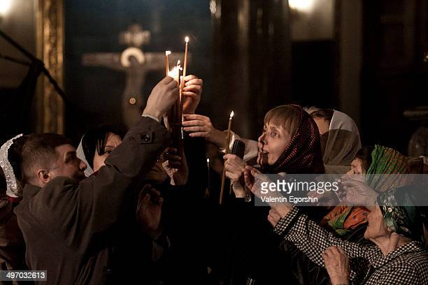 Believers during an Orthodox Easter service in Kazansky Cathedral. St Petersurg, Russia.