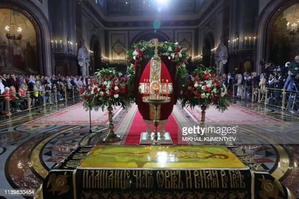 Believers gather for an Orthodox Easter service at the Cathedral of Christ the Saviour in Moscow on April 27 2019